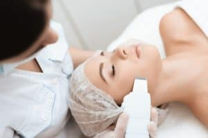 doctor cleanses woman s skin with special medical device 85574 6751 1